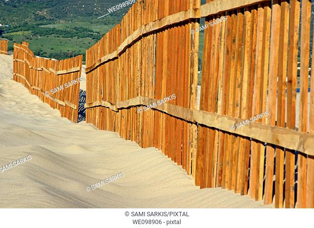 Fenced sand dunes at the beach in Tarifa, Andalusia, Spain