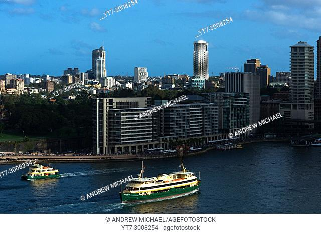 Aerial view of Ferries on their approach to Circular quay with Bennelong Apartments aka The Toasters. Sydney city centre, New South Wales Australia
