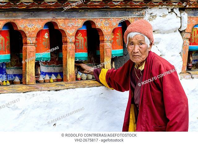 Woman praying at the monastery in Bhutan