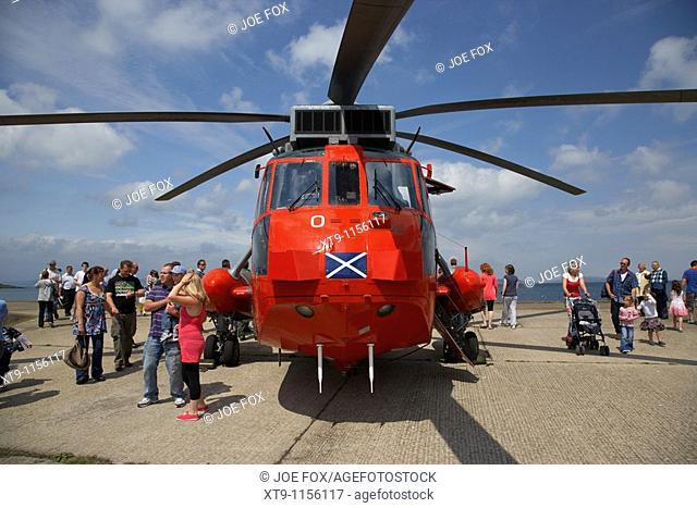 visitors on open day at Royal Navy Rescue Westland Sea King HU5 helicopter XZ920 visiting Bangor Northern Ireland UK