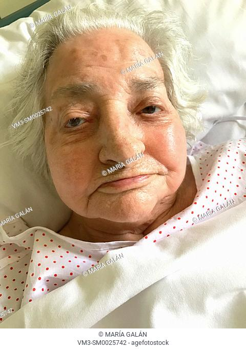 Old lady in bed. Close view