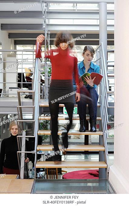 Businesswomen on steps in office