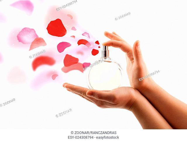 woman hands spraying rose petals