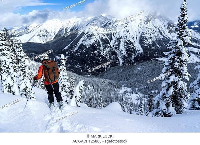 A female skis in the backcountry, Fernie, British Columbia, Canada