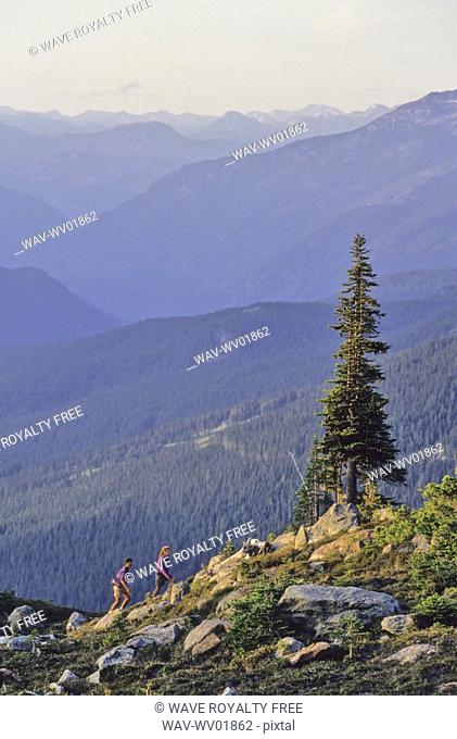 Couple hiking on Whistler Mountain, with coast mtn range in back