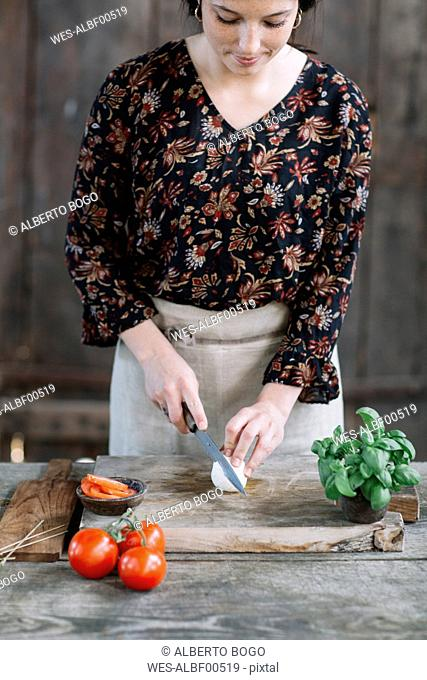 Woman preparing Caprese Salad
