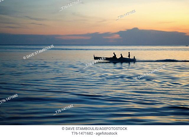 fishermen at sunset on Mabul Island, Borneo, Malaysia
