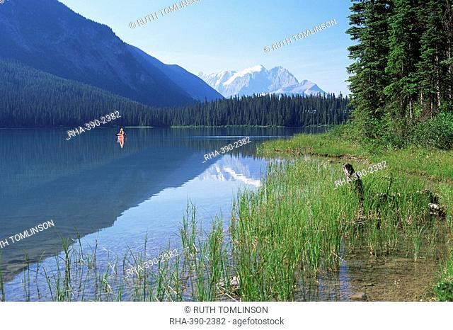 Canoe on water, seen from the western shore of Emerald Lake, Yoho National Park, UNESCO World Heritage Site, British Columbia B.C