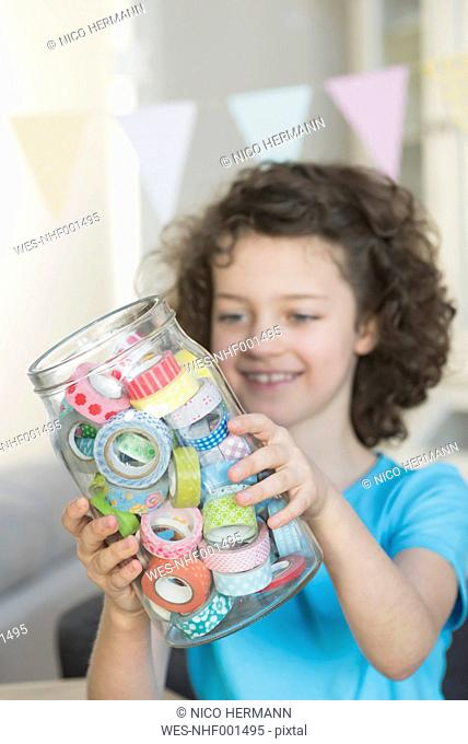 Girl holding jar with masking tape