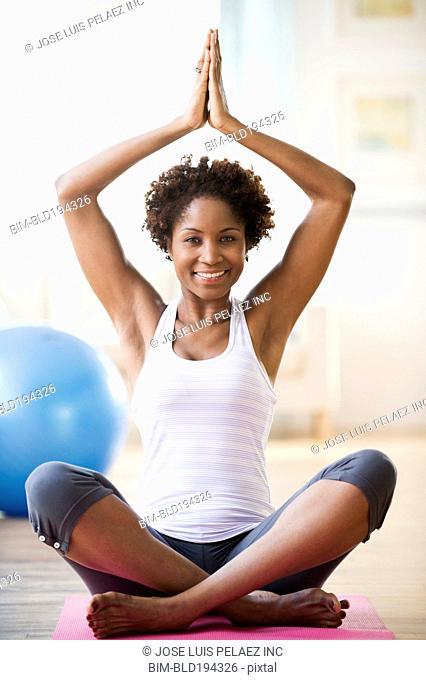 Black woman practicing yoga