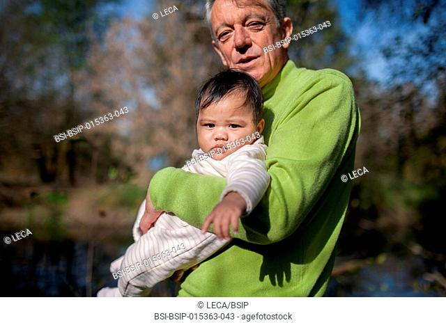 5-month old baby. This little Tahitian girl was adopted by people from the mainland of France