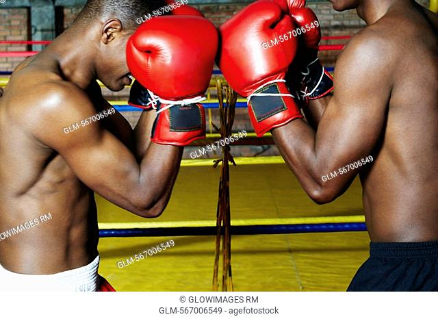Two young men boxing in a boxing ring