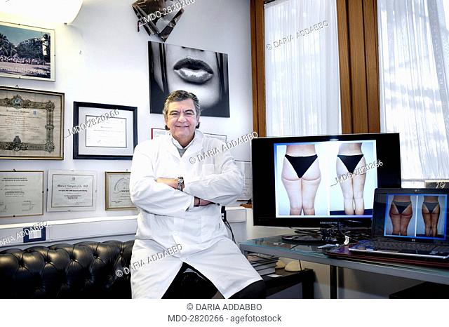 The professor and world famous plastic surgeon Marco Gasparotti posing seated on the sofa for a photocall shooted at his medical practice