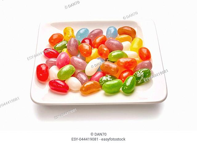 Colorful candies on the plate isolated on white background