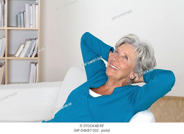 Senior woman relaxing on couch