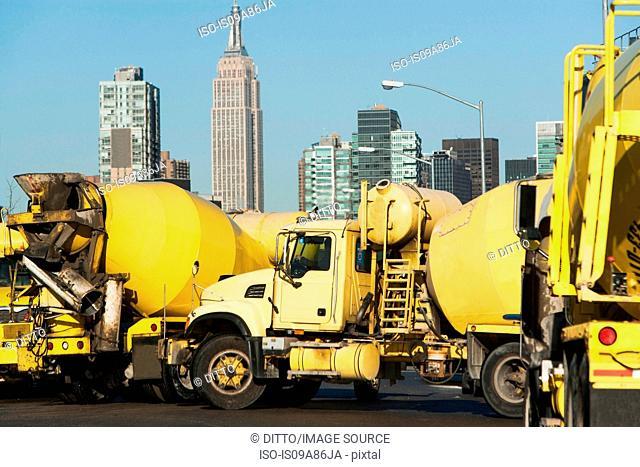 Yellow cement trucks in New York City, USA