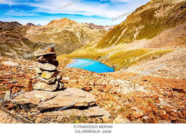 Stack of rocks, elevated view of lake in mountains