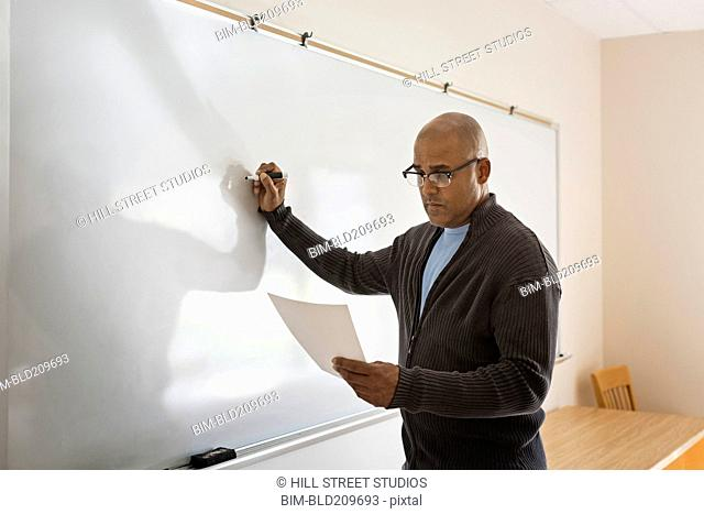 Businessman writing on whiteboard