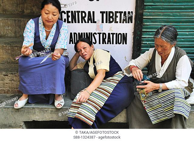 Tibetan women sitting together by the street