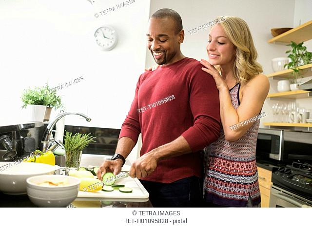 Couple preparing dinner in kitchen