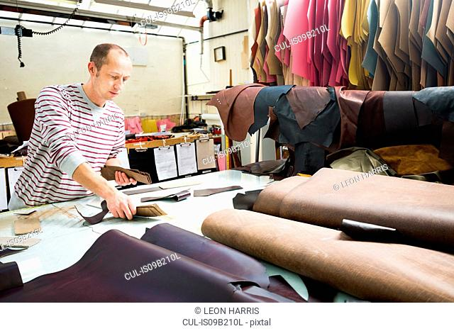 Man working in leather jacket manufacturers