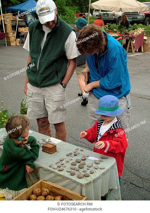 Montpelier, VT, Vermont, Farmer's Market, young girl selling stones at the Farm Market, vendor