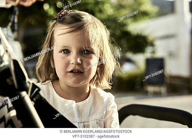 portrait of toddler daughter in buggy