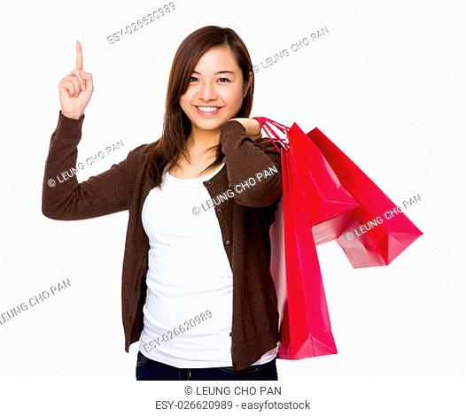 Young Woman hold with shopping bag and finger up