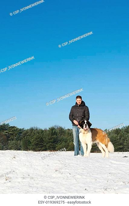 Owner with rescue dog in snow