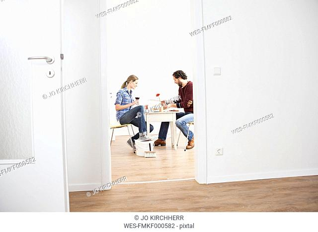 Couple eating pizza in new house