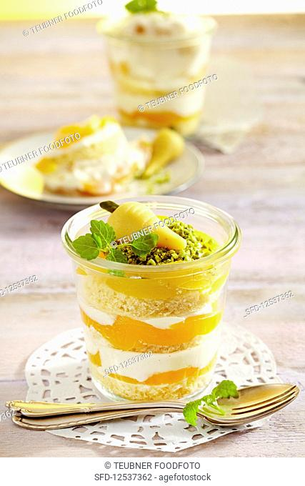 Apricot and quark layer cake in a jar decorated with a marzipan carrot