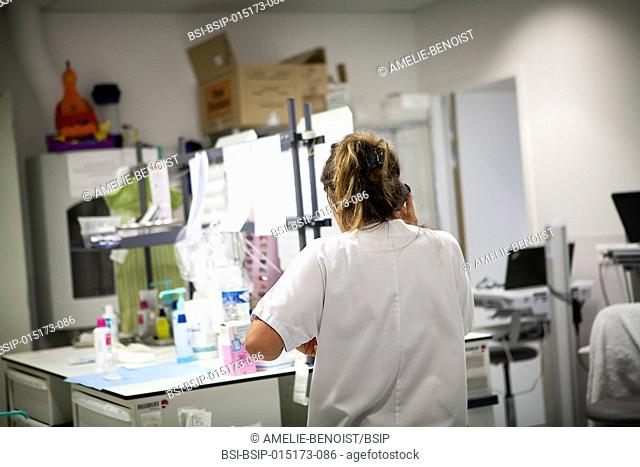 Reportage in the pediatric emergency unit in a hospital in Haute-Savoie, France. A nurse on the phone