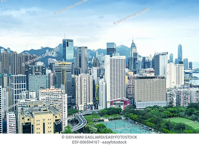 HONG KONG - MAY 5, 2014: Skyline of Hong Kong on a spring day. The city is a major tourist attraction with more than 30 million visitors each year
