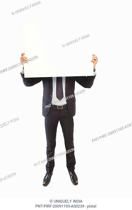 Businessman showing a blank placard