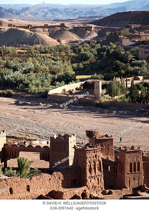 Village in lush valley, mountain in the background, Morocco