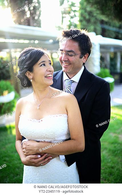 Candid exterior portraits of just married couple