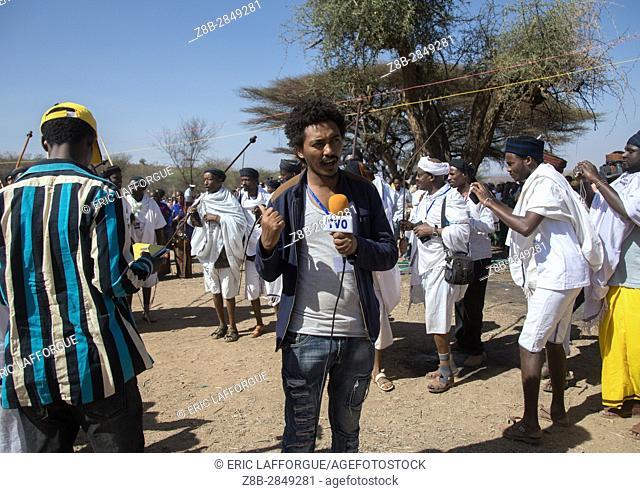 Ethiopian journalist during the Gada system ceremony in Borana tribe, Oromia, Yabelo, Ethiopia