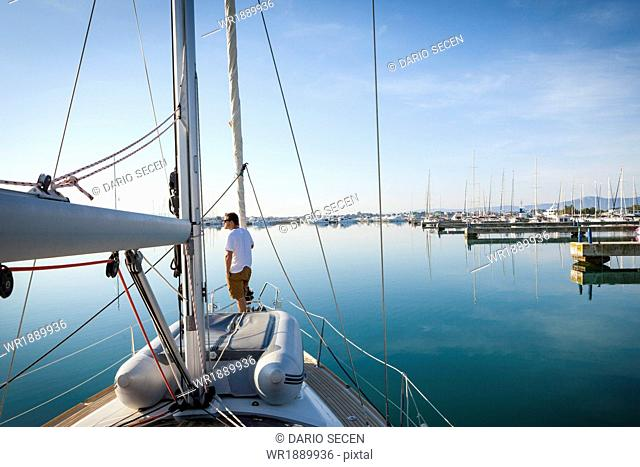 Sailboat entering marina, Adriatic Sea, Croatia