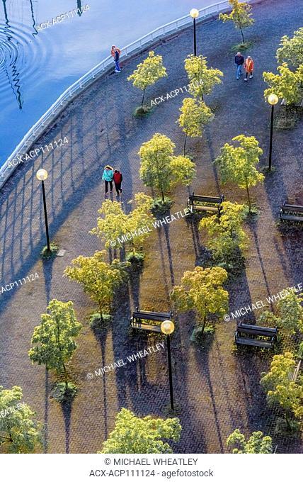 Pedestrians enjoy the False Creek seawall in Yaletown, Vancouver, British Columbia, Canada