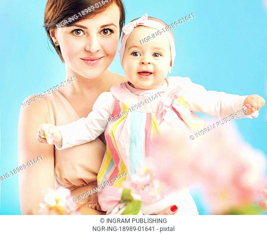 Charming mother with little cute daughter