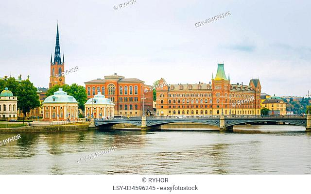 Stockholm, Sweden. The Vasa Bridge to Gamla stan over Norrstrom, with the Riddarholmen Church tower in the back