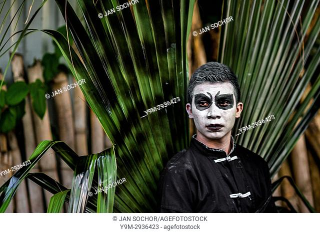 A Salvadoran young man, with white face paint, takes part in the La Calabiuza parade at the Day of the Dead celebration in Tonacatepeque, El Salvador