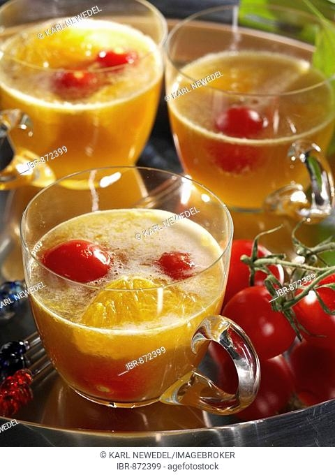 Tomato and orange punch with wheat beer in glasses