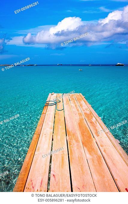 Formentera Ses Illetes beach pier Illetas with Ibiza background at balearic islands