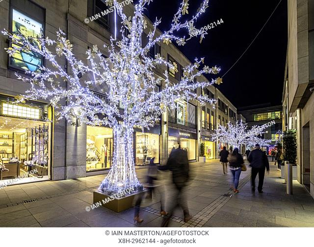 Night view of Multrees Walk upmarket shopping street with Christmas lights off St Andrews Square in Edinburgh , Scotland, United Kingdom