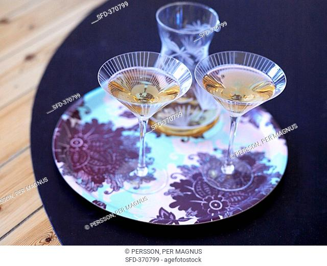 Martini in two glasses and a carafe