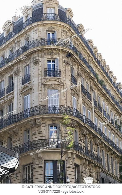 Delicate metal tracery, elegant proportions and sun washed hues of nineteenth century Belle Epoque architecture in Marseille, Provence, France