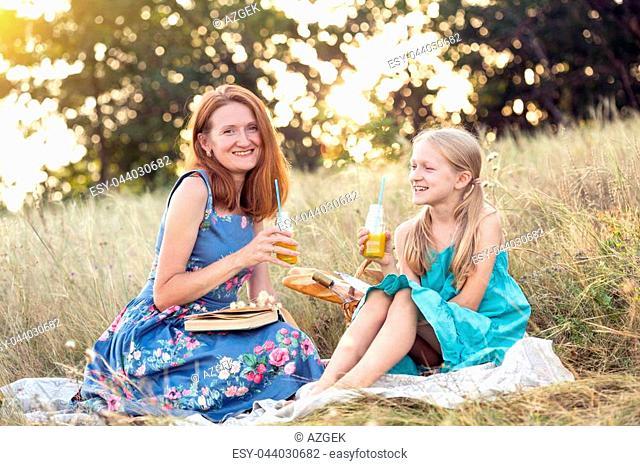Summer - happy family at a picnic. Fun mom and daughter at the picnic
