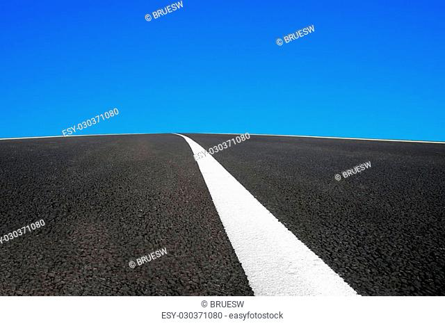 Asphalt road with white line and blue sky background