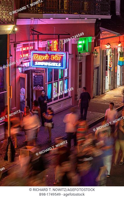 Neon lights and people walking on Bourbon Street, in French Quarter of New Orleans